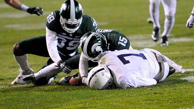 Tyson Smith (15) and Jermaine Edmondson (39) recover a fumble from Koa Farmer on a kickoff in the second half of MSU's 55-16 win over Penn State Saturday, November 28, 2015, at Spartan Stadium in East Lansing.