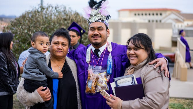 Western New Mexico University graduate Leighton Pogia who is from Hawaii earned a bachelor degree in social work from WNMU on Friday. He is pictured with his family.