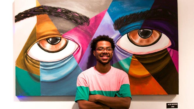 Terrance Vann, pictured here with one of his paintings, was one of the artists selected by the Wilmington Creative District to paint a mural for the 7th Street Arts Bridge. This is an example of  Vann's work.