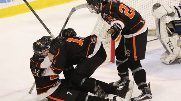 Mamaroneck's Alex Ewald  celebrates his opening goal with teammates Will Kirk (19) and Will Payne (20) during the first period Saturday. Mamaroneck defeated Pittsford 5-2.