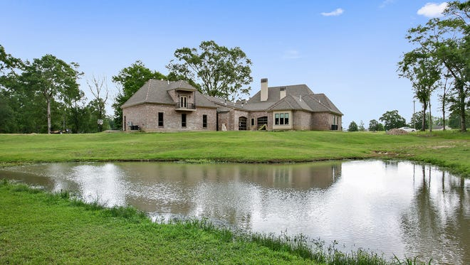 This home, located at 122 Cue Road in Lafayette, has 5 bedrooms, 4 baths home and 5,357 square feet of living area. It is listed at $1,695,000