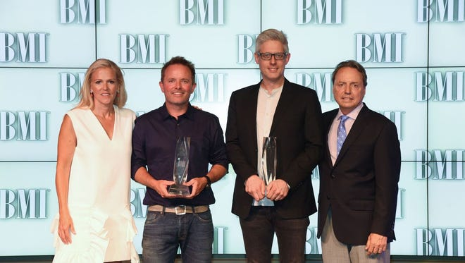 Leslie Roberts of BMI, Chris Tomkins, Matt Maher and Jody Williams of BMI.