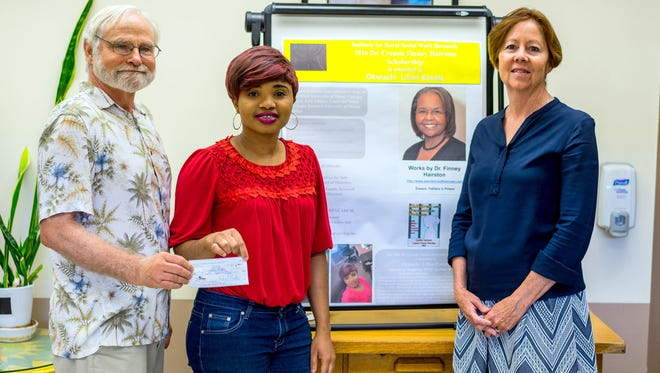 Pictured is Dr. Robert Rickle, scholarship recipient Okwuchi Lilian Ezeala, and WNMU Associate Vice President of Academic Affairs Dr. Linda Hoy.