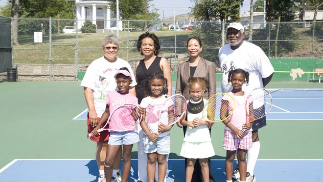 Rachel Fair (back, left) and Anthony Pack (back, right) with Inner City Tennis Players in 2008.