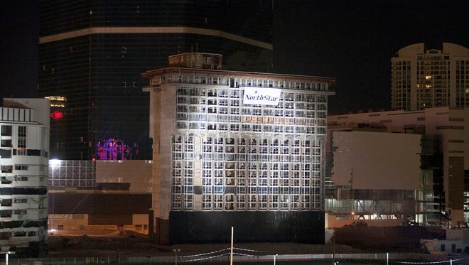 The Riviera casino's Monte Carlo tower is imploded in Las Vegas Tuesday, Aug. 16, 2016. The Las Vegas Convention and Visitors Authority now owns the property and is spending $42 million to level the 13-building site.