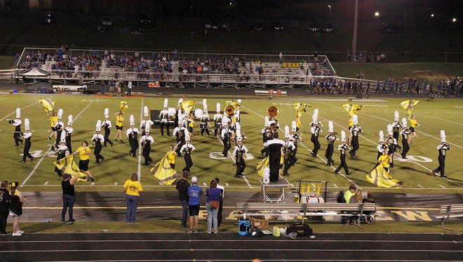 The Fairview High School Sound 'O Gold Marching Band performs their half-time show at the Nest on September 9, 2016.