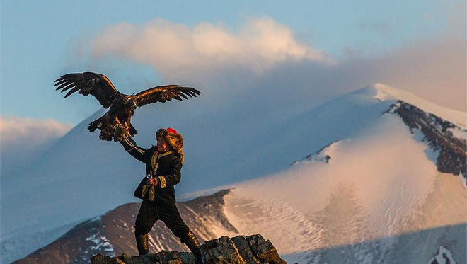 """Aisholpan practices her craft in """"Eagle Huntress."""""""