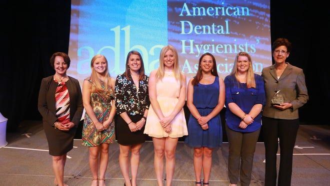 From left, Jill Rethman, American Dental Hygienist Association president; with SUNY Broome students Sarah Mannina, Amy Squier, Kathryn Birmingham, Allison Fitzgerald and Shannon Curley; and SUNY Broome dental hygiene professor Maureen Hankin.