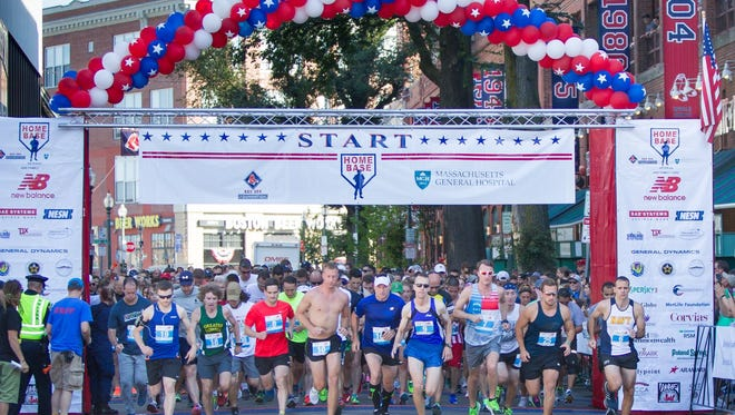 Runners participate in annual Run to Home Base fundraising event in Boston. The event is coming to JetBlue Park late January to benefit local vets.