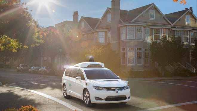 Google-run Waymo unveiled its new self-driving Chrysler Pacifica minivans at the North American Auto Show Sunday.