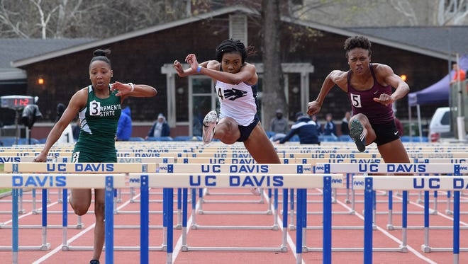 Fiyin Olusola, middle, shown during an event last season earned bronze in the 60-meter hurdles Saturday in the Mountain West indoor track and field championships.