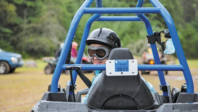 A woman rides in a UTV in Wisconsin