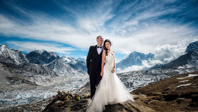 Ashley and James pose for one of their many wedding photos on Mt. Everest.