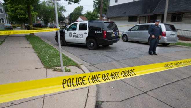 Milwaukee police investigate a double homicide on the city's south side in July 2015.