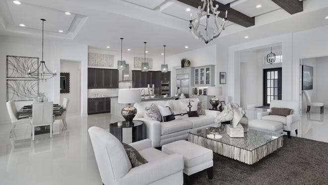 Vogue Interiors' Sheila Corasaniti, IDS and Salvatore Giso, IDS have completed the interior design for Stock Custom Homes' Merano model at Lakewood Ranch.