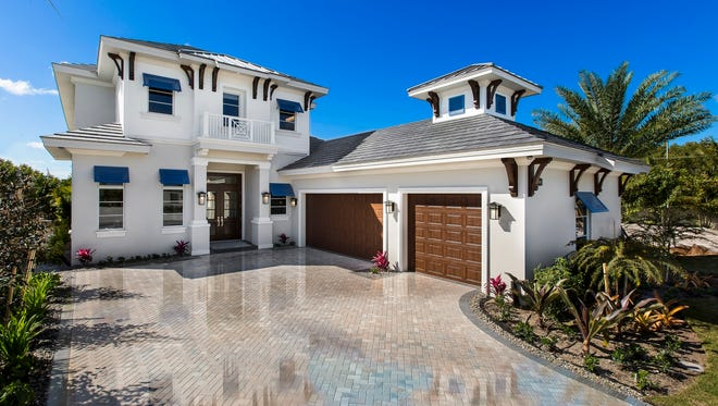 A new furnished Grenada model is one of three completed models open at Seagate's Windward Isle communitysouth of Orange Blossom Drive on Airport-Pulling Road in North Naples.