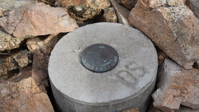 """Arizona Trail: Gila River Canyons passage. The """"golden spike"""" monument bears the initials of Dale Shewalter, the """"Father of the Arizona National Scenic Trail."""