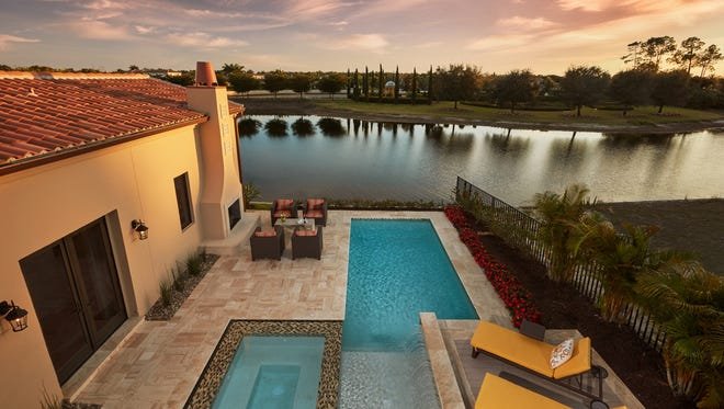 The Capriano model in Mediterra's Lucarno neighborhood is one ofLondon Bay Homes' one- and two-story single-family villa designs.