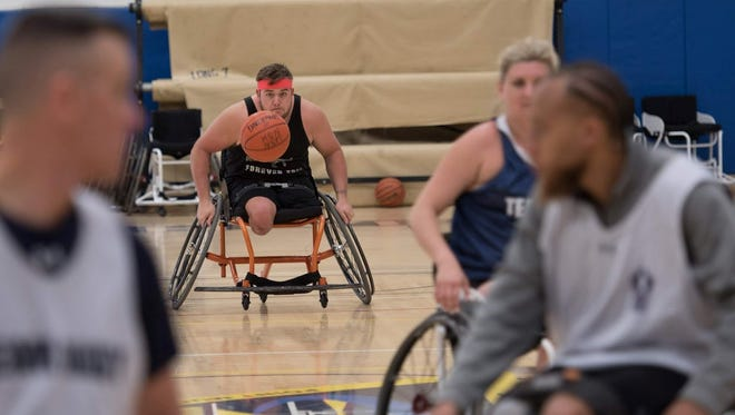 Doug Hill, a retired navy officer from Corbin, Kentucky, competes in a game of wheelchair basketball.