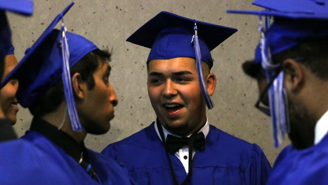 McQueen High School celebrates during its graduation ceremony at Lawlor Events Center in Reno on June 14, 2018.
