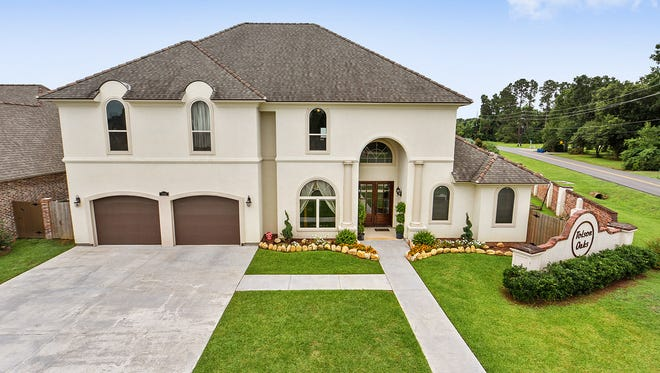 This5Bedroom, 3 1/ 2 half bath home is lpocated at 700 N. Michot Road in Lafayette. It is listed at$997,500.