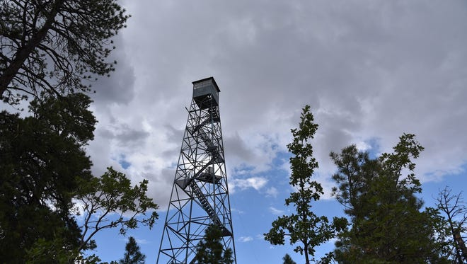 Grandview Lookout fire tower under stormy skies.