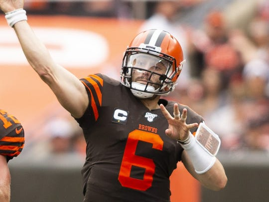 Sep 8, 2019; Cleveland, OH, USA; Cleveland Browns quarterback Baker Mayfield (6) throws the ball for a first down against the Tennessee Titans during the third quarter at FirstEnergy Stadium. Mandatory Credit: Scott R. Galvin-USA TODAY Sports