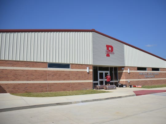 The Pineville Rebels moved into their new $2.6 million fieldhouse on Sunday. The fieldhouse, which includes a state-of-the-art weight room and locker room among other amenities, was made possible by a $20 million bond issue passed in November 2011.