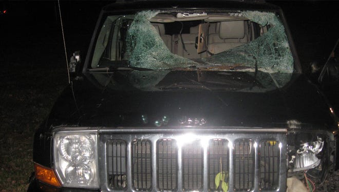 A deer went over the hood and through the windshield of this SUV, police said.