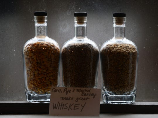 Jars of corn, rye and malted barley sit on a window sill in the tasting room of Lyon Distilling Company in St. Michaels, Md. The distilling business produces rum and whiskey.