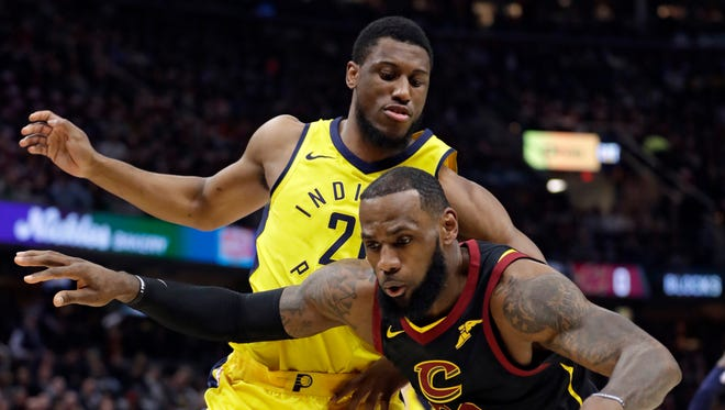 Cleveland Cavaliers' LeBron James, right, drives against Indiana Pacers' Thaddeus Young during the first half of Game 2 of an NBA basketball first-round playoff series Wednesday, April 18, 2018, in Cleveland.
