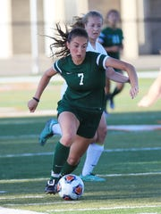 Novi's Vera Razburgaj (7) controls the ball during