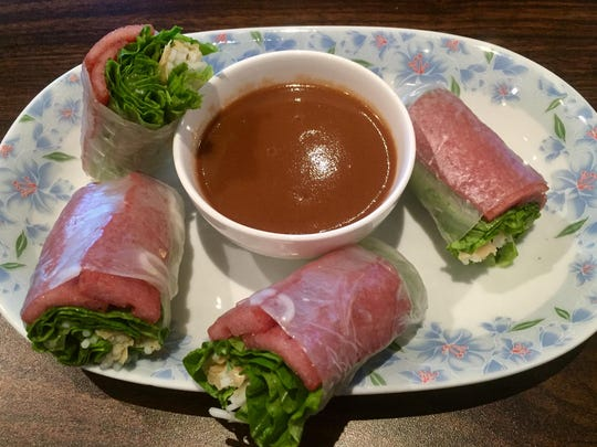 Summer rolls are filled, among other ingredients, with slices of grilled pork loaf.