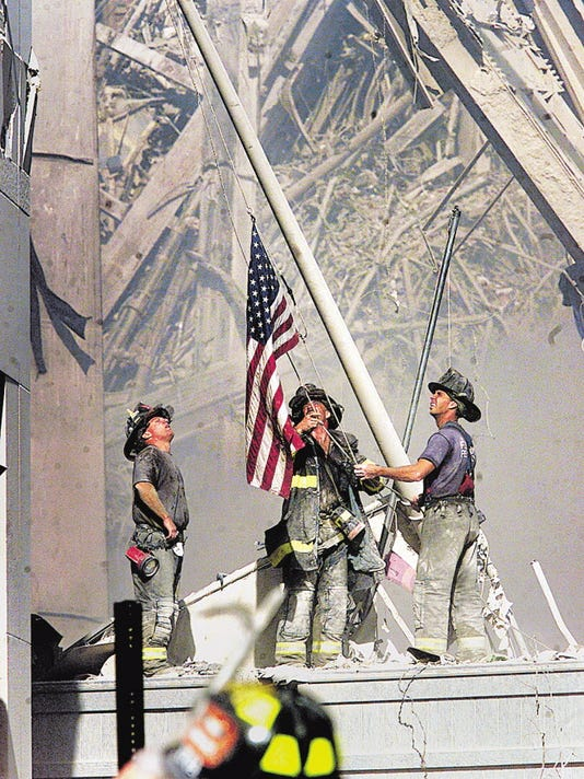 Firefighters raise flag