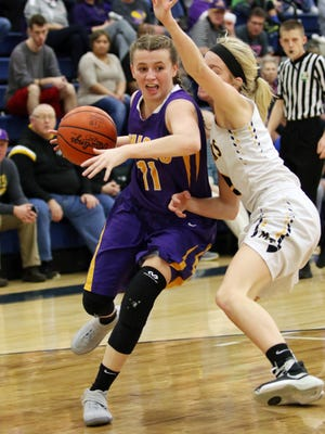 Unioto's Emily Coleman works against Miami Trace's Cassidy Lovett during the second quarter of Saturday's Division II sectional final at Adena High School. The Shermans saw their season come to a close, falling 57-35.