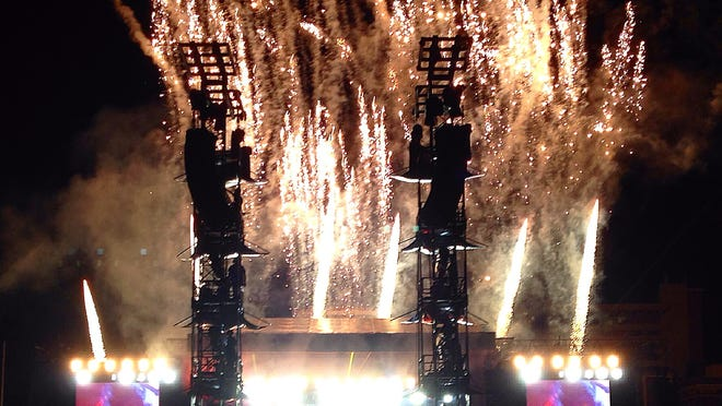 """Fireworks erupt from the stage while Paul McCartney plays """"Live and Let Die"""" during his concert in Missoula on Tuesday."""