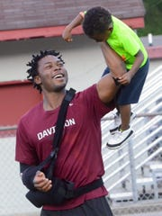 Ani Izuchukwu greets a young fan during Monday's practice at Davidson Academy.