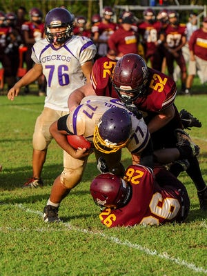 In this file photo, the Geckos and the Friars battle for the IIAAG High School Football League championship.