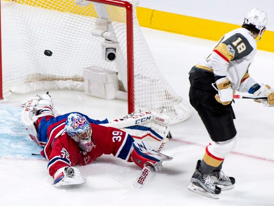 Montreal Canadiens goalie Charlie Lindgren dives to deflect a shot from Vegas Golden Knights' James Neal during the first period of an NHL hockey game, Tuesday, Nov. 7, 2017, in Montreal. (Paul Chiasson/The Canadian Press via AP)