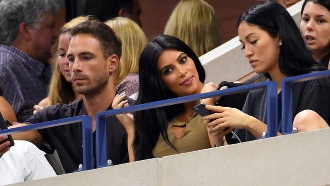 Kim Kardashian (center)  on day nine of the 2015 U.S. Open watching Serena Williams play Venus Williams.