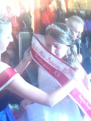 Alexandra Dudek receives her sash after she is crowned Little Miss Polonia 2017 - Wallington.
