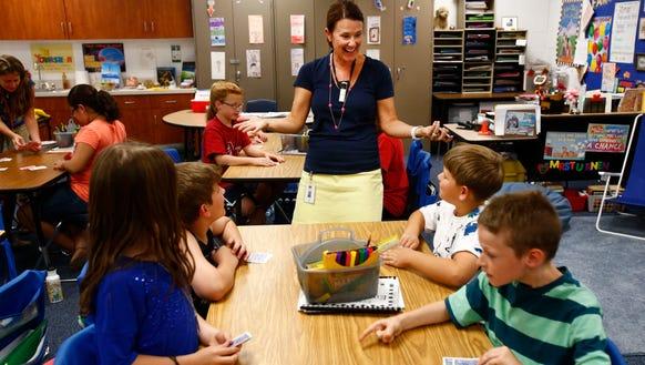Teacher Brenda Turnen works with third graders at Scott