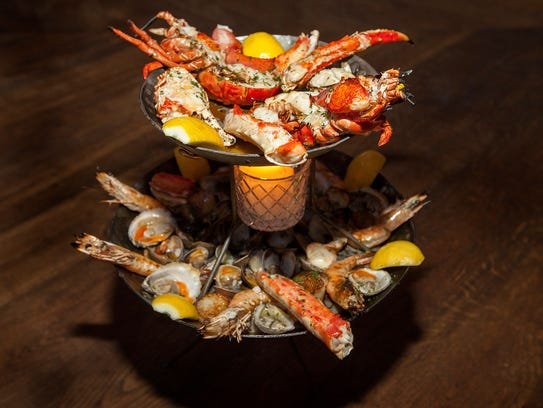 Fire roasted seafood tower from Maple & Ash in Chicago,