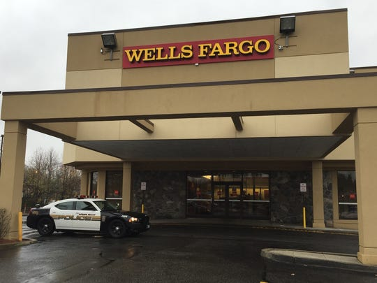 A Spring Valley police car outside the Wells Fargo bank branch in the Spring Valley Marketplace.