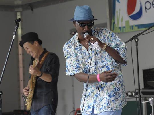 A 13-piece band and four singers — Lenny Watkins, Tosha