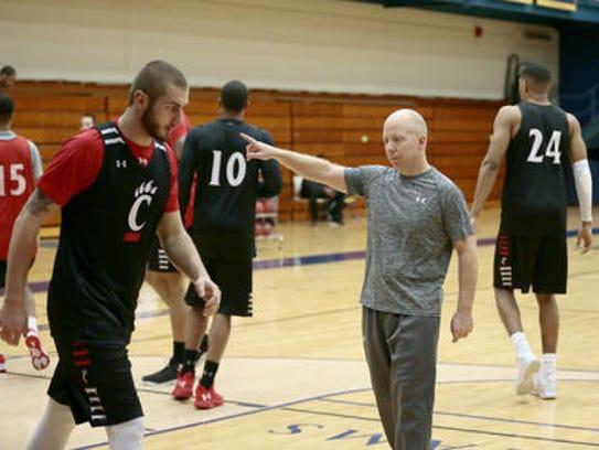 University of Cincinnati coach Mick Cronin directs
