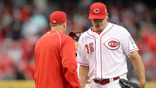 Reds relief pitcher Kevin Gregg (36) is pulled out of the game by manager Bryan Price after surrendering a two-run home to Pirates center fielder Andrew McCutchen in the eighth inning of the Opening Day game on Monday.