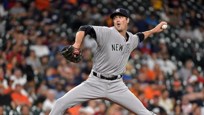 New York Yankees relief pitcher Andrew Miller delivers in the ninth inning of a baseball game against the Houston Astros, Tuesday, July 26, 2016, in Houston.