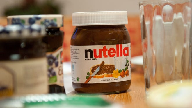 "A picture taken on January 8, 2014 shows a pot of Italian hazelnut and cocoa spread ""Nutella"" on a breakfast table in Inzell, Germany."