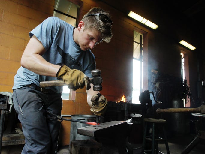 Sam Riehl, an 18-year-old blacksmith and vice president of the Louisiana Metalsmiths' Association, works at the shop he shares with Richard Delahoussaye Monday, August 11, 2014, in Carencro, La.